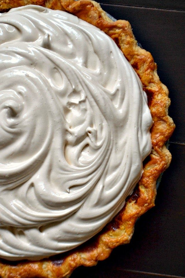 Creamy brown sugar pumpkin pie topped with a fluffy light meringue that is sweetened with honey.      This photo was taken by Owen, my 6 y...