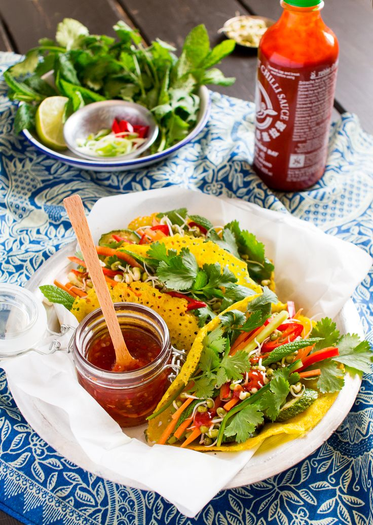 Crispy Vietnamese pancakes are deep filled with a range of colourful veggies, homemade mung bean sprouts and fresh herbs with a side of tangy dipping sauce.