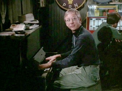 William Christopher as Father Mulcahy - playing the piano