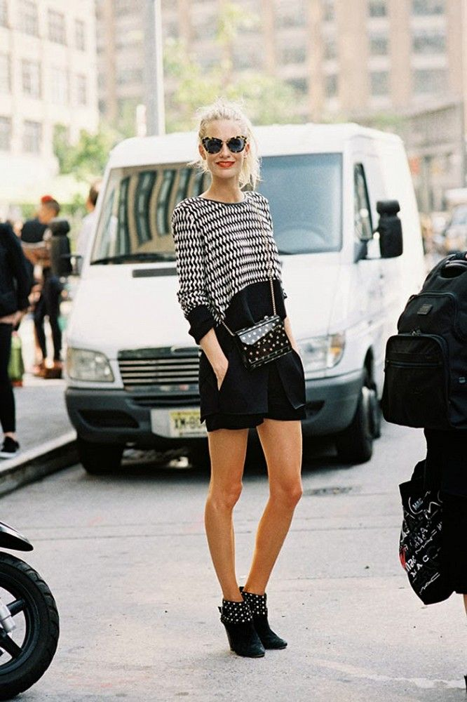 Poppy Delevingne's playful + chic style: printed top worn with studded boots and a printed bag