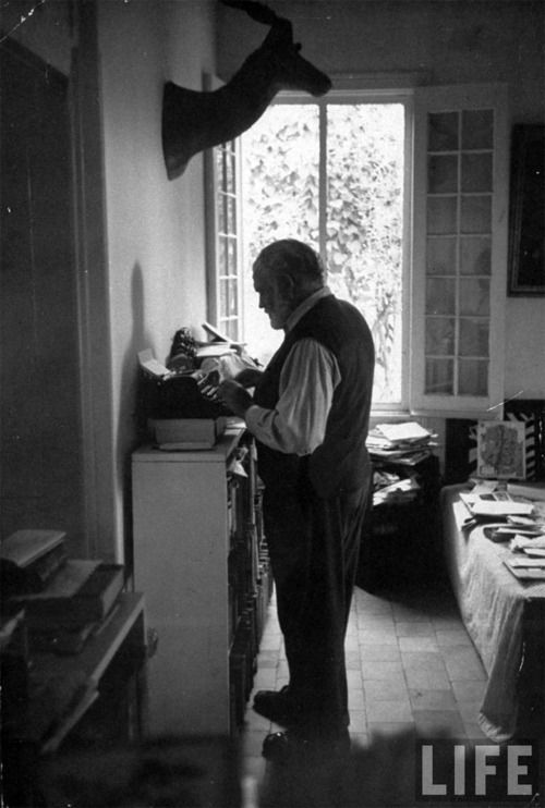 Ernest Hemingway's standing desk:  A working habit he has had from the beginning, Hemingway stands when he writes. He stands in a pair of his oversized loafers on the worn skin of a lesser kudu; the typewriter and the reading board chest-high opposite him. - Paris Review, 1958