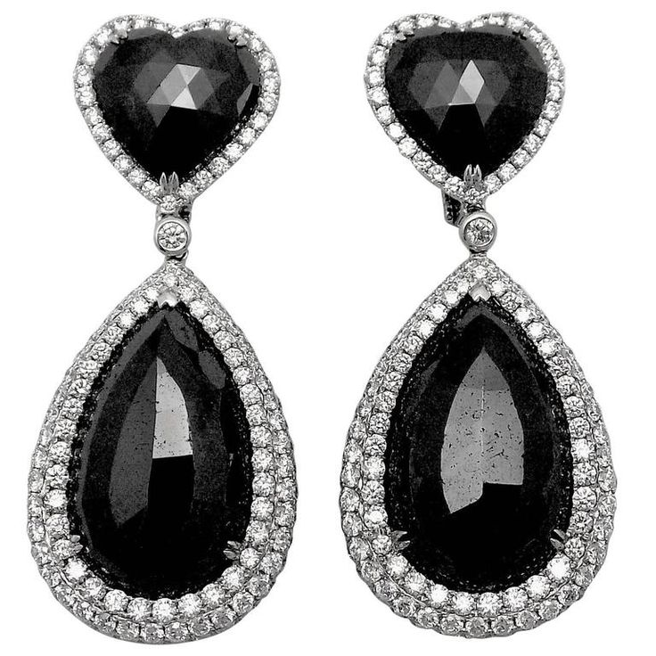 Important Black and White Diamond Pendant Earrings | From a unique collection of vintage drop-earrings at https://www.1stdibs.com/jewelry/earrings/drop-earrings/