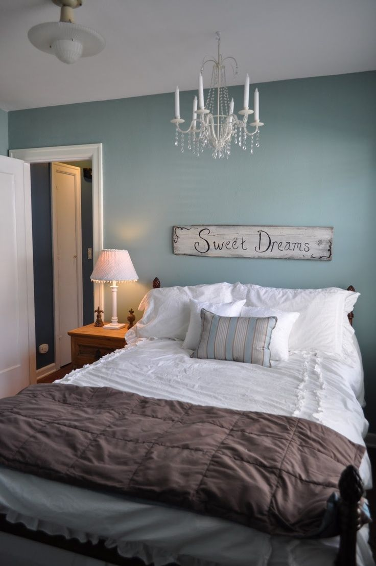 Colors: Blue, White, Grey, Beige-Brown, Design: Simple, good for a guest bedroom or teenager's room. Clean and comfortable, I like the accent piece behind the bed (very welcoming) and the chandelier makes it a tad elegant