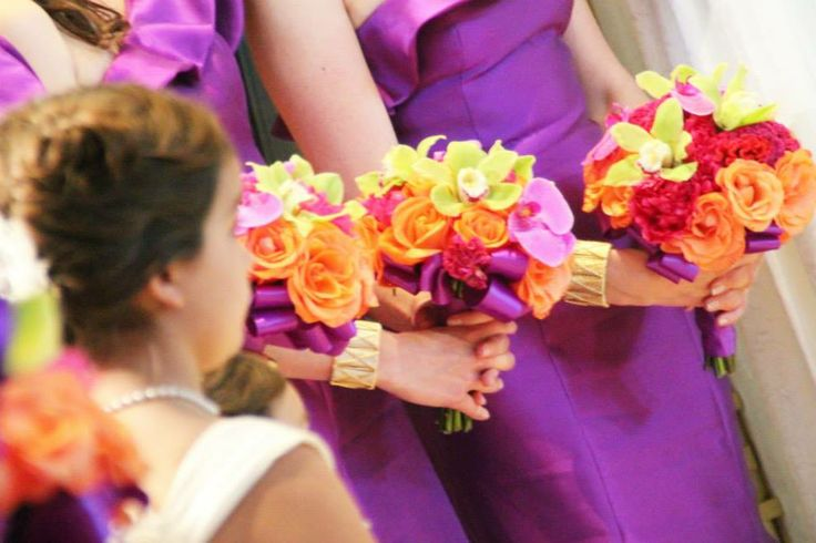 Northern Greenhouses #wedding Bright and vibrant bridesmaid's bouquets consisting of lime green cymbidium orchids, orange roses, fuschia and hot pink coxcomb and lavender phalaenopsis orchids. Excellent pop of color!