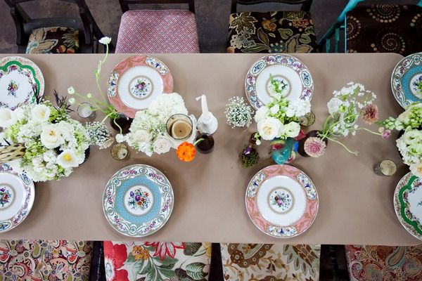 Love mismatched china.....haven't thought of mismatched fabric chairs, but I like that too!