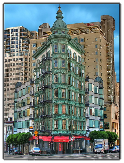 """San Francisco green building / Sentinel Building  Green building in front of the Hilton Hotel, near the Transamerican Pyramid.  San Francisco (CA). (Francis Ford Coppola's """"Zoetrope"""" restaurant at the ground floor)"""