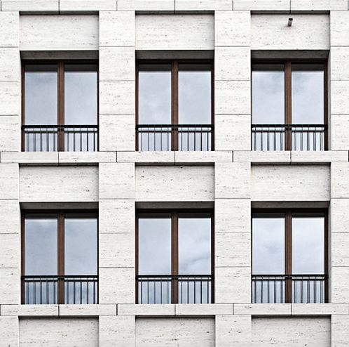 Facade of the Haus am Max Reinhardtplatz in Berlin by KLeihues + Kleihues Architekten. Photo taken from the Deutsches Architektur Forum, edited by NOMAA|marco jongmans.