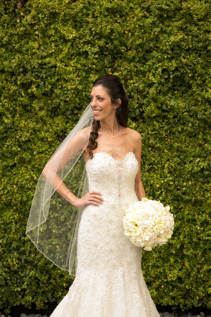 Elegant bridal style: Allure Bridals fit and flare wedding dress paired with a veil (Ashley Blake Photography)
