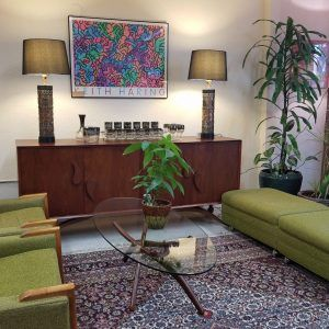 Currently Available: *Keith Haring lithograph, 1986 *Forest Wilson Coffee Table *Unidentified rosewood credenza *Metal cylinder lamps with Asian motif *Rose embellished barware set with caddy *Unidentified rocking Lounge chairs with matching ottomans