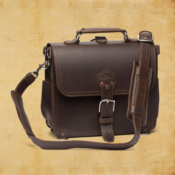 """""""1 full-sized interior pocket for handguns or power cords, which can be pressed flat when not in use""""    So, if you're fully charged, you can also be fully loaded.  Seriously though, I want this Satchel."""