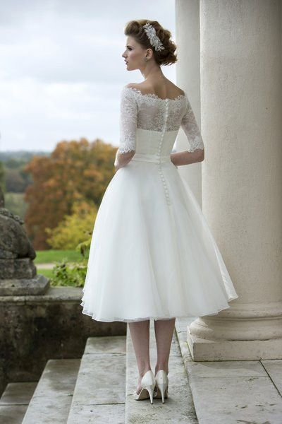 Pippa -  Tea length dress with full organza skirt, lace bodice with sleeve and delicate lace trimmed neck line