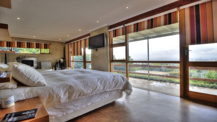 Bedroom leading to balcony and overlooking the Paarl valley #views #luxury #bedroom #decor #design #inspiration #lifestyle