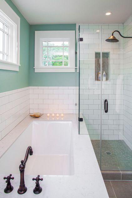 frameless shower; large single unit tub -- Transitional Bathroom by CG&S Design-Build