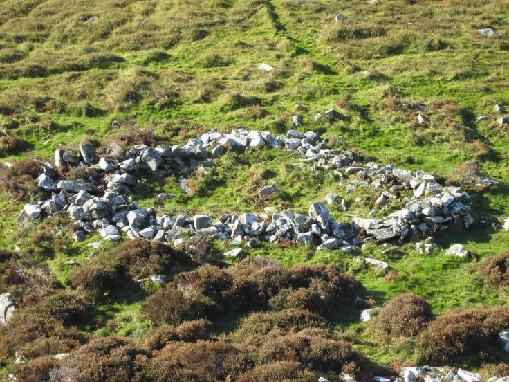 Bronze Age roundhouse on the flank of the mountain