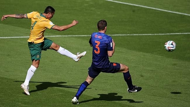 Tim Cahill's epic strike heads towards goal.