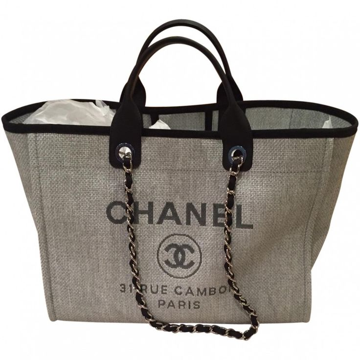 Brand New in Box  Chanel Large Grey Deauville Tote with Silver Chain.  This is Chanel Cruise 2016 Collection, it's a gorgeous grey with black handles. It can be worn as a tote and a shoulder bag. It's rare and hard to to get.  Packaging: Dustbag, Original box    Packaging: Dustbag