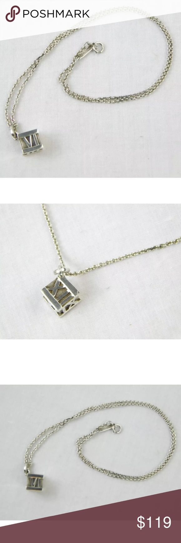 """Tiffany & Co. Sterling Roman Numeral Cube Necklace Tiffany & Co. Sterling Silver Roman Numeral Atlas Cube Necklace  Sterling silver 925  Roman Numeral Atlas cube design Hallmark """"2001 Tiffany & Co. 925"""" Lobster claw closure  Chain link necklace Made in Italy  Condition: Very faint surface scratches on front & back. Does not come with box or bag.  Dimensions Length: 16"""" Pendant: .25 x .3625""""  100% Authenticity Guarantee Tiffany & Co. Jewelry Necklaces"""