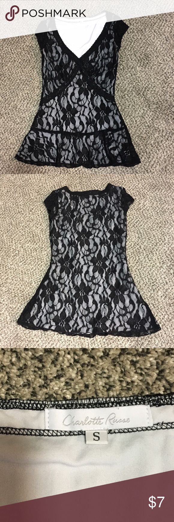 Lace black and white blouse Semi used black and white charlotte ruse V-neck blouse in excellent condition Charlotte Russe Tops Blouses