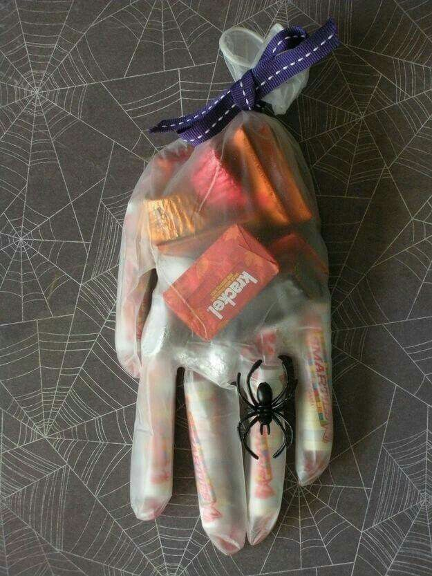 Add CANDY to a vinyl GLOVE to hand out for Halloween or for party favors! This is such a fun idea & I bet the Kids will absolutely love them!  via The Queens Card Castle