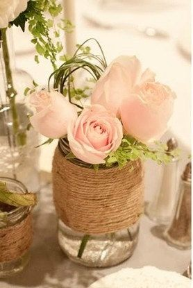 twine wrapped mason jars for bud vases (light pink roses, peonies, and/or hydrangea) Maybe do larger arrangement with peonies and hydrangea and stick with simple roses in these?