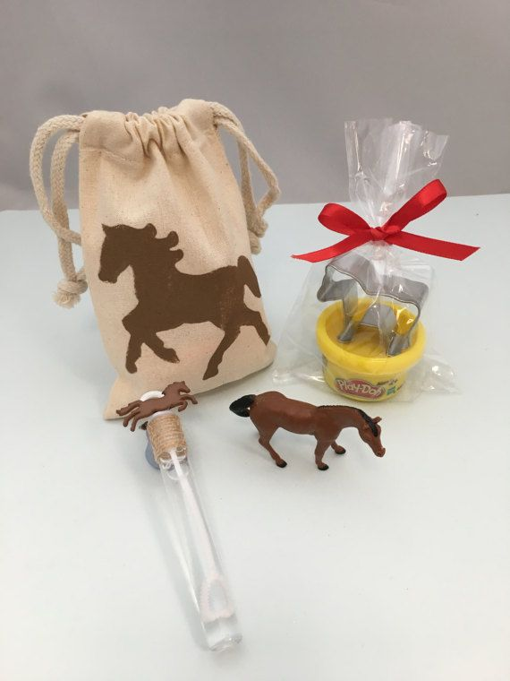Horse theme drawstring bags (4 x 6) filled with a mini Play Doh and horse shaped cutter, a horse theme bubble wand and a small plastic horse toy. These are perfect goody bags/favors for a Horse Party, a Western Party or and Equestrian Party. Please note that you will receive a selection of different colored Play Doh and one horse from a selection of different colors in each party bag.  Check out our other Horse party supplies: https://www.etsy.com/shop/MadHatterParty...