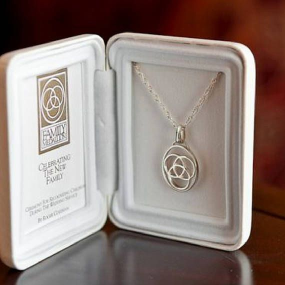 The Family Medallion® -Sterling Silver- a meaningful way to include children in a blended family wedding ceremony.