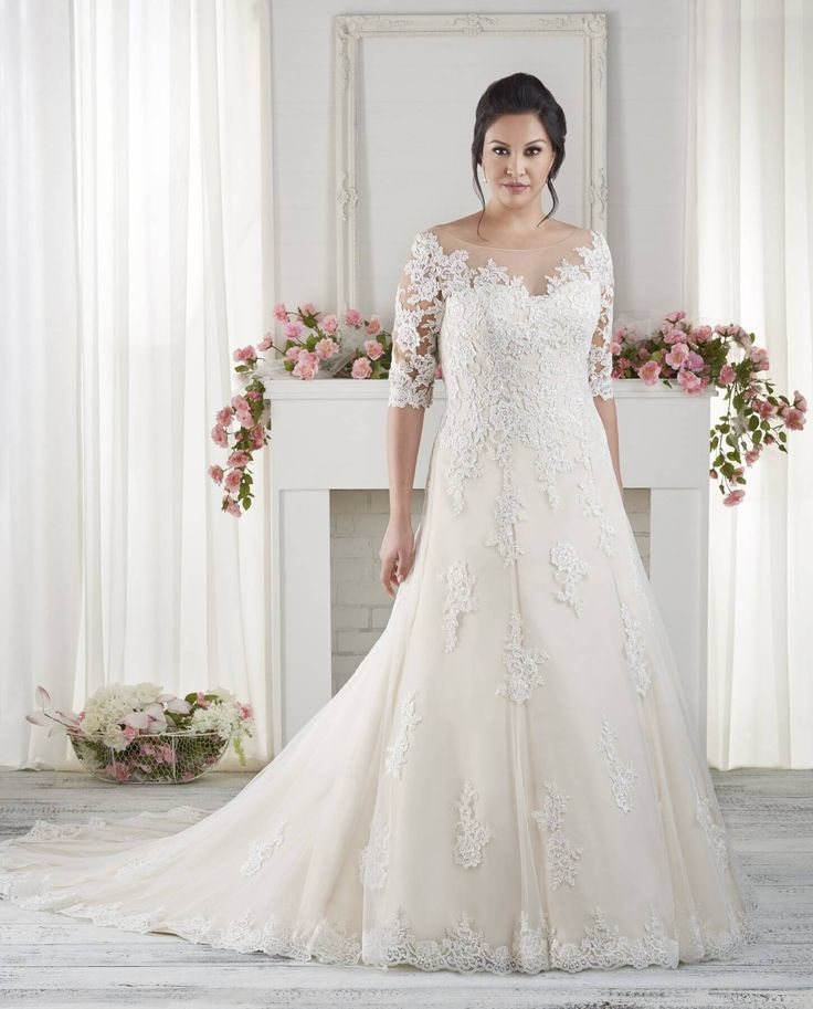 2. Elbow length sleeved wedding dresses - The Best Wedding Dresses for Brides with Fat Arms - EverAfterGuide