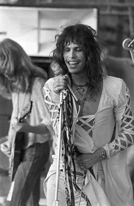 Steven Tyler in a dress looking thing...........Dude looks like a lady!!!!
