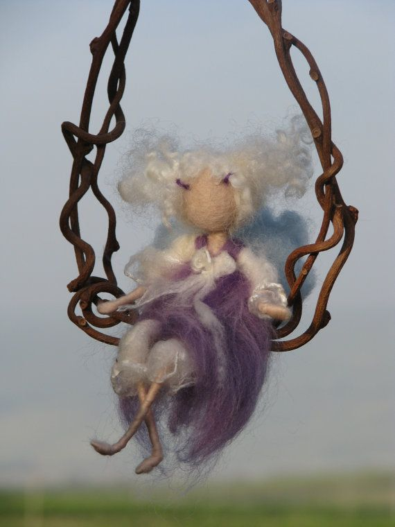 Hey, I found this really awesome Etsy listing at https://www.etsy.com/listing/185398980/purple-fairy-on-a-twig-needle-felted