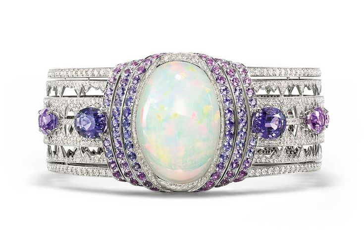 Chaumet high jewellery bracelet in white gold set with a 39.05ct cabochon-cut white opal from Ethiopia, brilliant-cut diamonds, oval-cut violet sapphires from Ceylon and Madagascar and round violet sapphires, from the Lumieres d'Eau high jewellery collection.
