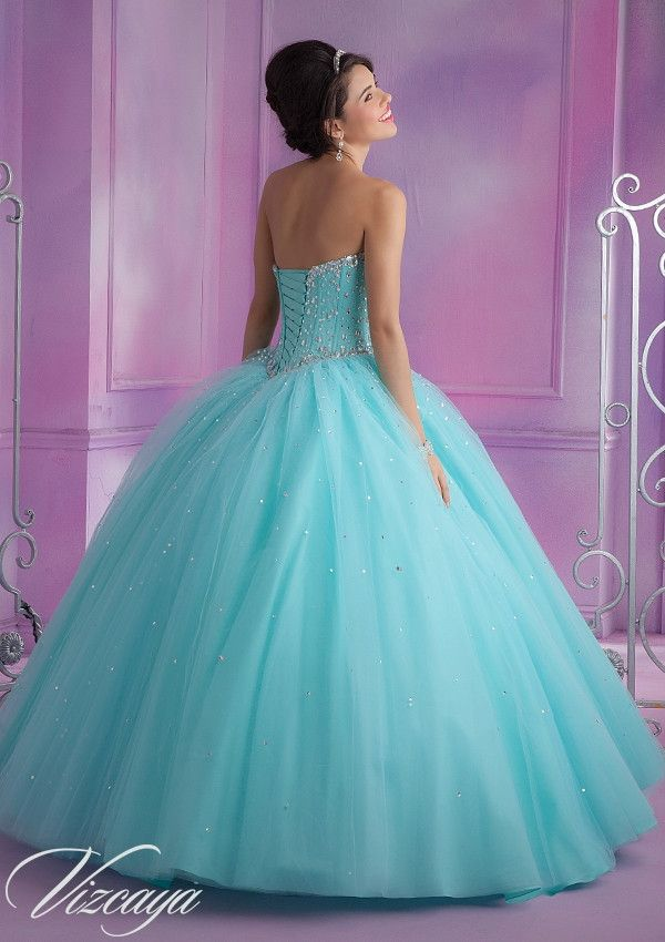 Dance the night away in this absolutely stunning Princess ball gown! Sparkling crystals adorn the corset sweetheart bodice. You are sure to steal the show in this amazing gown which is perfect for Qui