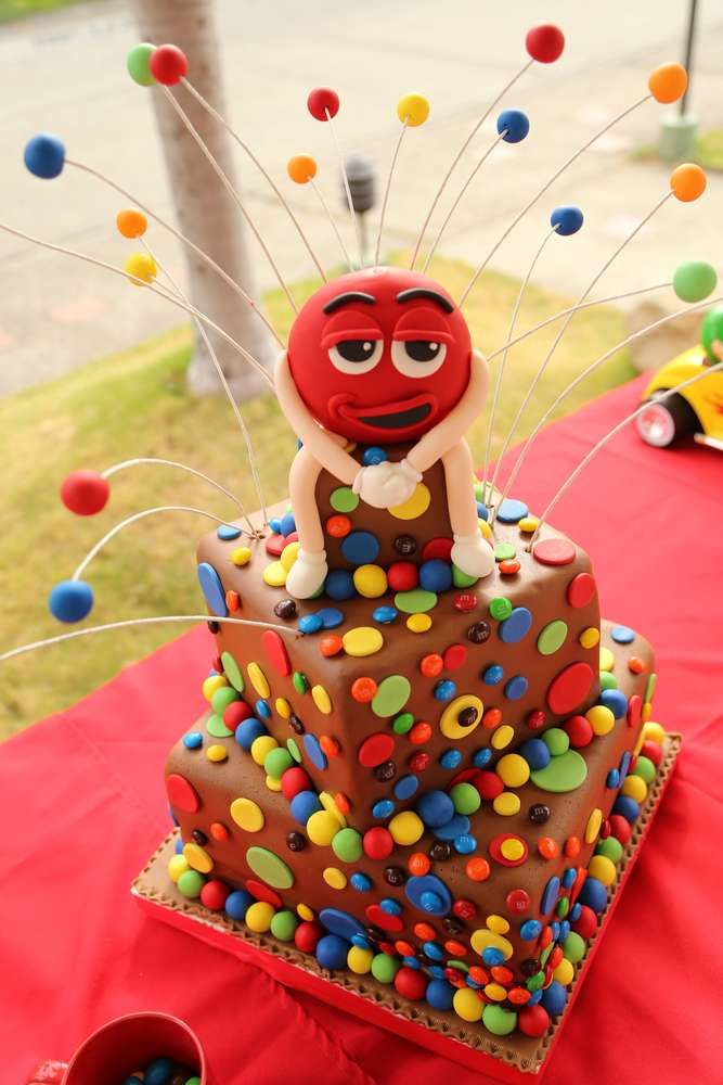 Fun cake at a M&M's birthday party!  See more party planning ideas at CatchMyParty.com!