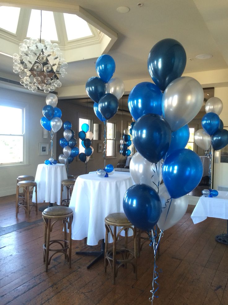 Very elegant - midnight blue, sapphire blue and Silver. A mix of table centrepieces (5 balloons in each) and our floor arrangements (9 balloons - 2m tall)