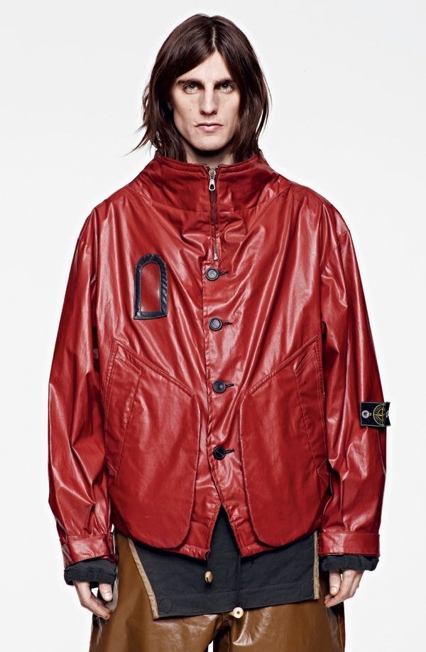 The Brand : Stone Island Corporate cotton canvas with a thick matte PVC coating and latex detailing. 1983