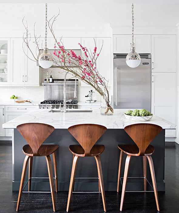 ... A Charcoal Gray Kitchen Island Topped With White Marble Fitted With A  Stainless Steel Sink And Pull Out Faucet Lined With Cherner Counter Stools.