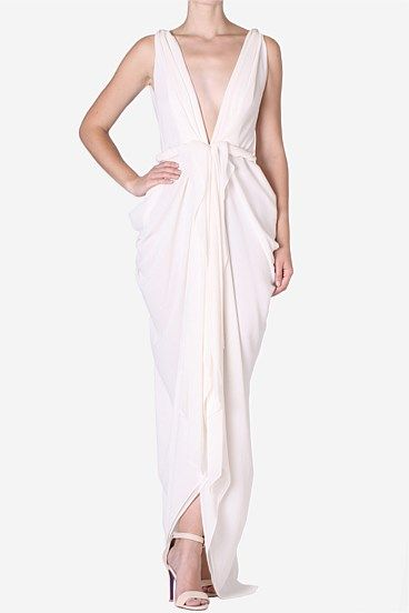 Porcelain Forget Me Knot Gown  This layered georgette gown flatters the figure with its plunging neckline and soft draping. Platted detailing adds a Grecian touch perfect for location wedding. Complete the look with swept back hair pairing with classic accessories.