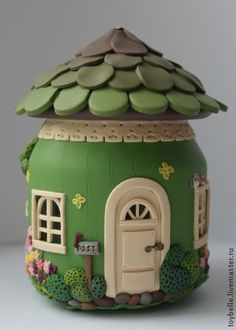 Beautiful green clay jar fairy house