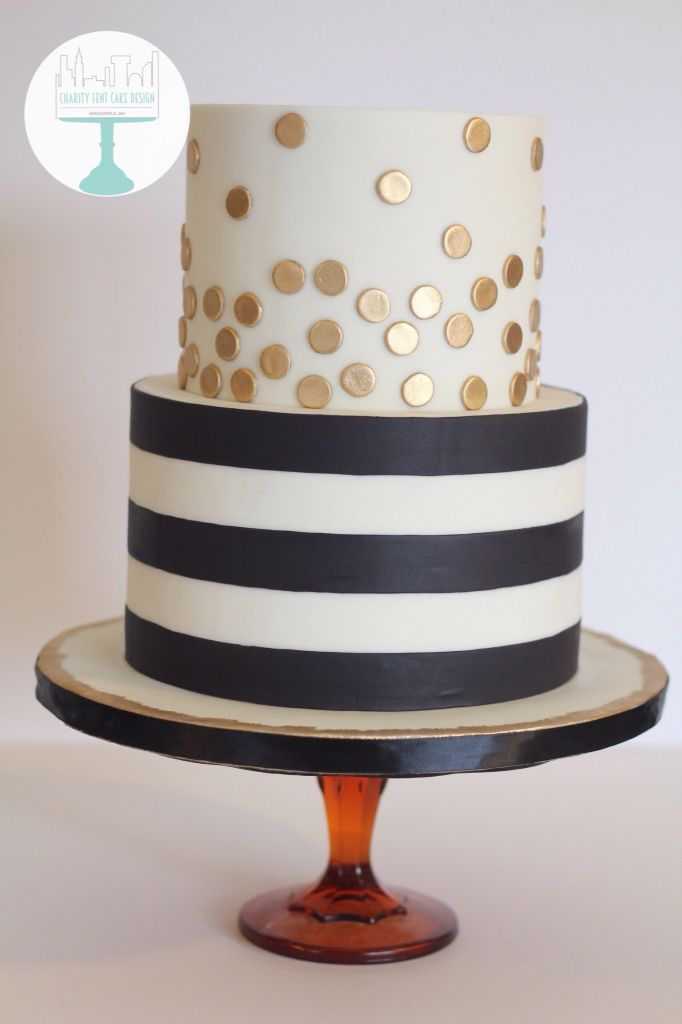 Black and white striped birthday cake. Metallic gold polka dots