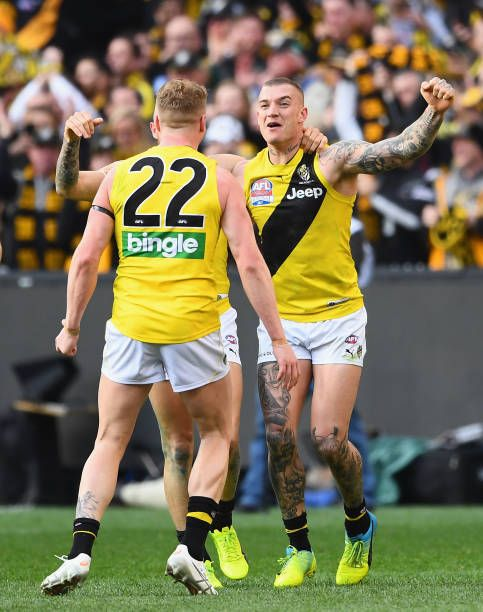 Josh Caddy Brandon Ellis and Dustin Martin of the Tigers celebrate winning the 2017 AFL Grand Final match between the Adelaide Crows and the Richmond...