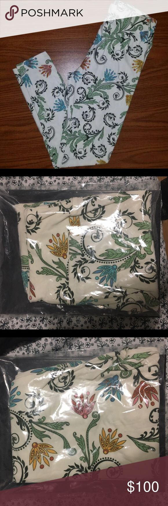 LuLaRoe UNICORN MAJOR UNICORN PRINT! Brand new LuLaRoe Os leggings made in Indonesia. Cream leggings with with dark olive green paisley and blue, pink, yellow floral. Brand new. Never worn, never tried on. LuLaRoe Pants Leggings