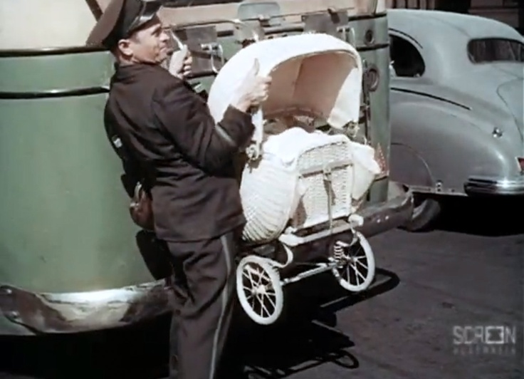Bus Driver removing pram from back of bus, Perth, 1954