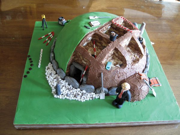 This cake was commissioned by the Office of Public Works for the launch of the new Knowth volume, 'The Archaeology of Knowth in the First and Second Millennium AD', which coincided with the 50th anniversary of the first excavations at Knowth by Professor Eogan and his team. The 'finds' include a marzipan macehead and some flint arrowheads, as well as surveying paraphernalia and megalithic art on the kerbstones. This edition of edible archaeology appeared in issue 281 of Current Archaeology.