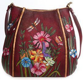 Magnifique Lilies Leather Hand Painted Shoulder Bag  Trendy, Cute and Luxurious Hand Painted Leather Purses      Hand painted leather purses are truly eye-catching, unique and cool.  In fact they are currently trending like crazy!  Obviously when you combine beautiful hand painted art, on fine quality leather the result is a timeless and charming creation just for you.