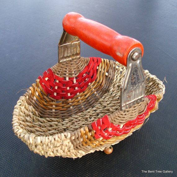 "Handmade Basket from Pastry Blender with Red Leather Detail  This basket started as a pastry blender! I use the vintage blenders for the basket frame by pulling the wires apart; they become the initial 'ribs'. The blender's handle remains the handle of the basket. I add more ribs and weave using several materials, including leather, seagrass, and vine rattan.  4 1/2"" x 7"" and 5 1/2"" tall. This old blender has some rust on the side and marks of use on the handle"