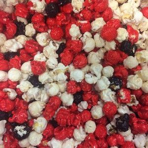 Our freshly popped gourmet red (Strawberry) white (Vanilla) and black (Blackberry) popcorn is candy coated. This bright red white & black popcorn is a perfect for a Pokemon themed party or meetup. Del