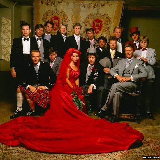 Bob, Paula, Duran Duran, Spandau Ballet, George Michael, David Bowie .. some other familiars I can't.quite.place.    THAT RED DRESS!    Just your average wedding.. x