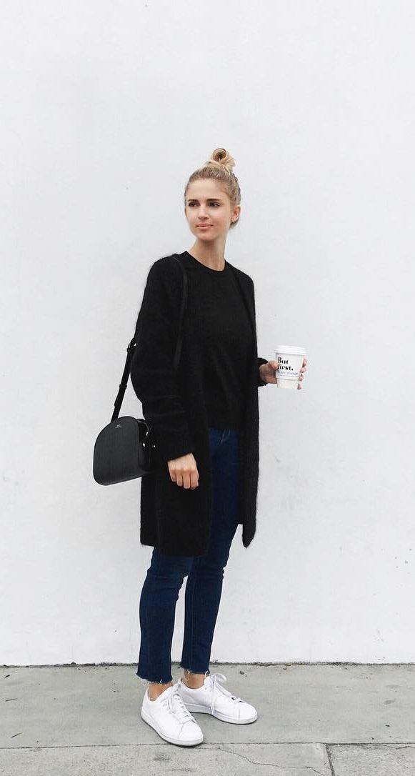 A black cardigan, knit top, jeans, and sneakers.
