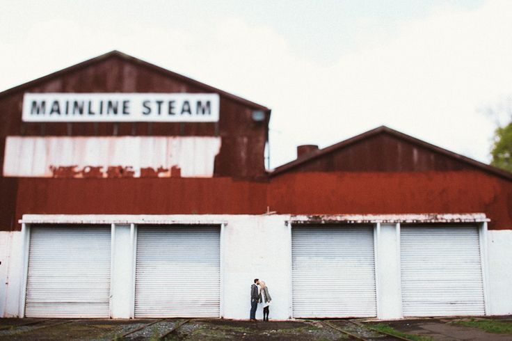 Mainline steam tilt shift by brad boniface, auckland city vsco photo shoot with couple in front of steam yard
