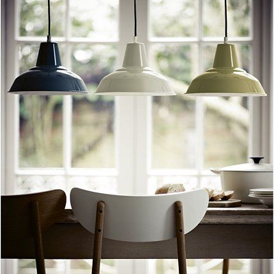 Pendant lights over kitchen table.