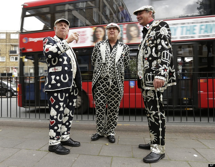 John Scott, the Pearly King of Mile End, left, Jimmy Juker, the Pearly King of Camberwell and Bermondsey, center, and Shaun Austin, the Pearly King of Tower Hamlets talk outside a pub in London's Tower Hamlets Borough Thursday, July 19, 2012. The Pearly Kings were at the pub for an event to promote the Cockney language and culture in London's East End as the city prepares for the 2012 Summer Olympics.